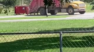 Dump Truck Drives Off with Dumpster