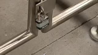 Subway station lock on small gate is pointless
