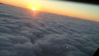 Clouds and sunset from a plane