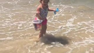 Collab copyright protection - toddler faceplants when waves come