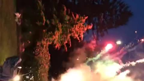Man lights up fireworks attached to his hands, shoots into the sky