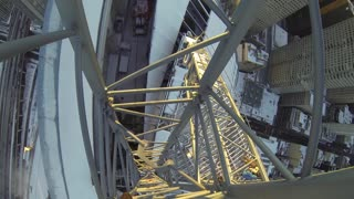 Daredevil Climbs Icy Crane - Video