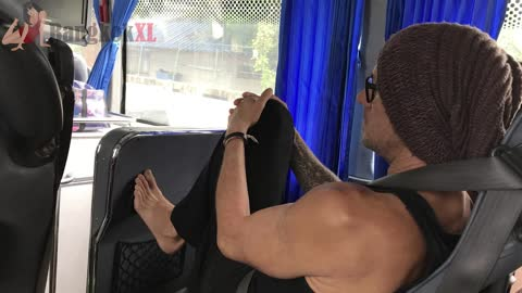 Shameless Backpacker With Bare Feet Out On Bus