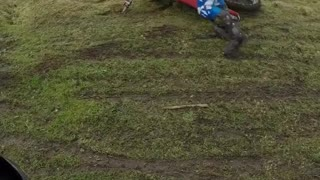 Bmx rider in blue falls off bike unto grass  - Video