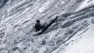 Guy back flips off small ledge on skis and lands face first into snow