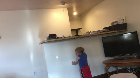 Toddler chases light like a cat