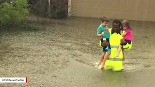 Image Of Deputy Rescuing Two Children From Houston Flood Waters Goes Viral - Video