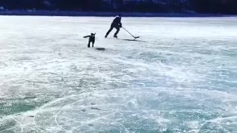 Labrador Plays Hockey On A Frozen Lake