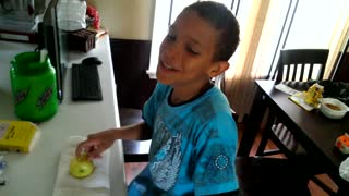 Boy Smashes Apple With His Head - Video