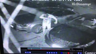 Security cam a drink explodes on a guy after leaving car - Video