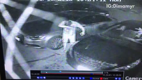 Security cam a drink explodes on a guy after leaving car