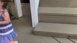 Toddler thinks she's jumping off the stairs  - Video