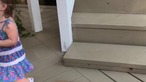 Toddler thinks she's jumping off the stairs