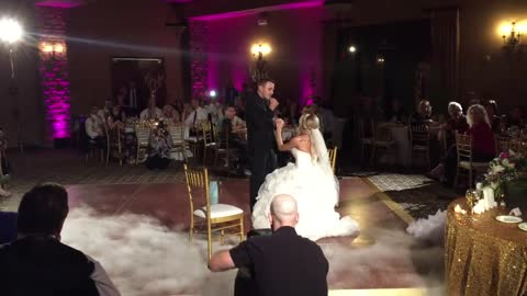 Groom delivers surprise original song after first dance