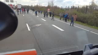 Migrants Along the A216 Outside of Calais - Video