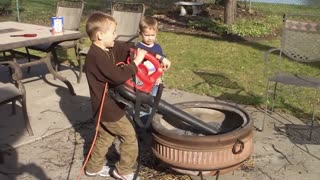 Kids Fail To Clean Fire Pit With Leaf Blower - Video