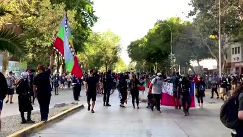 Tear gas and water cannon fly in Chile protest