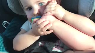 Toddler thinks her foot is a phone  - Video