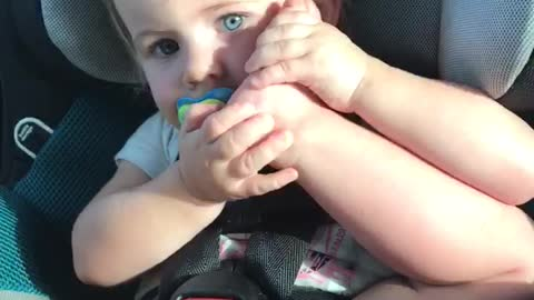 Toddler thinks her foot is a phone