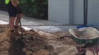 LAZY TRADIE FILLING WHEEL BARROW - Video