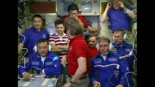 Hugs and smiles as new space station crew clocks in - Video