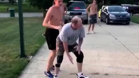 Elderly Man Shows Youngster How To Really Play Basketball