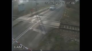 Cyclist miraculously survives collision with speeding train - Video