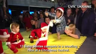 Baby Santas crawl to finish line - Video