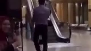 Escalator Going Down Guy Up - Video