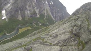 Point-of-view wingsuit flight over Norwegian cliffside