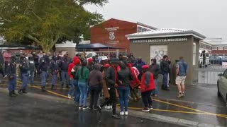 A small group of EFF supporters protest outside Brackenfell High School