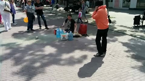 Street artist playing 'drums' !