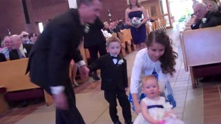 Baby Flower Girl Makes Unforgettable Wedding Entrance - Video