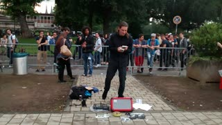 Street performer creates music using 2 Game Boys