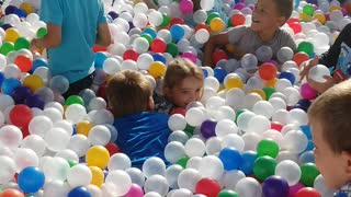 Children drown in colored balls