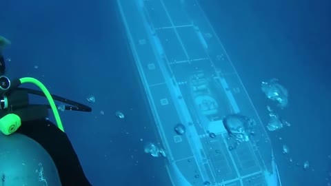 Submarine Passes Right Beneath Hawaii Scuba Divers