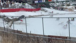 Intensely dangerous crash during snowmobile race - Video