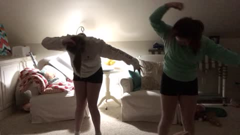 Two Teens Dance To Music Until One Trips Over A Toy