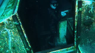 Washing Hands Inside a Sunken Boat