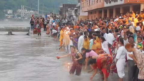 Tourist falls into river during religious ceremony in India