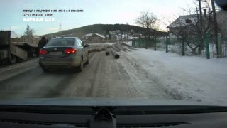 Truck's Load Rolls into Oncoming Traffic - Video