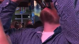 Guy in blue shirt drinking beer  - Video