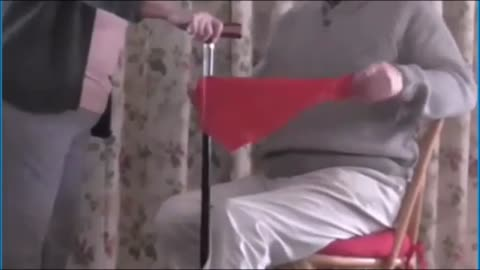 A Silk Passes Right Through A Walking Cane In Full View - Slow Motion