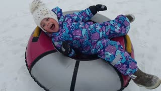 Riding on a donut in the winter