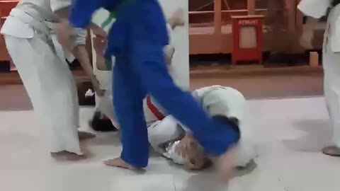 Karate guy martial arts tries to carry two friends collapses