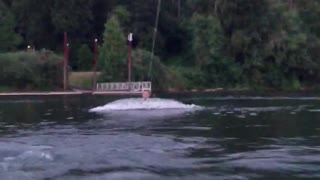 Wakeboard guy gets pulled and stands up then instantly falls forward into water - Video
