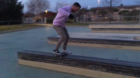 Guy in pink shirt face plants onto a skateboard