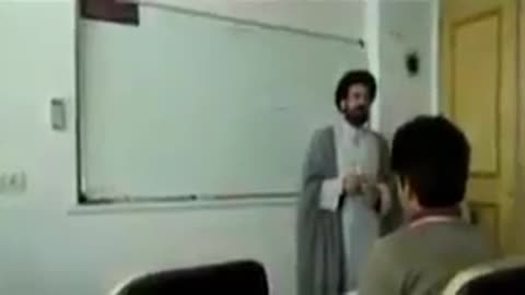 A mullah teaching Spanish to students