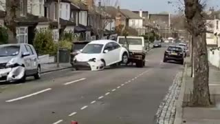 Tow truck driver smashes VW Beetle into FOUR parked cars on a London street