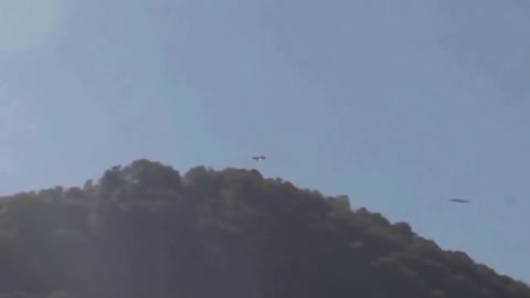 UFO Lurking Behind Mountain Caught On Video